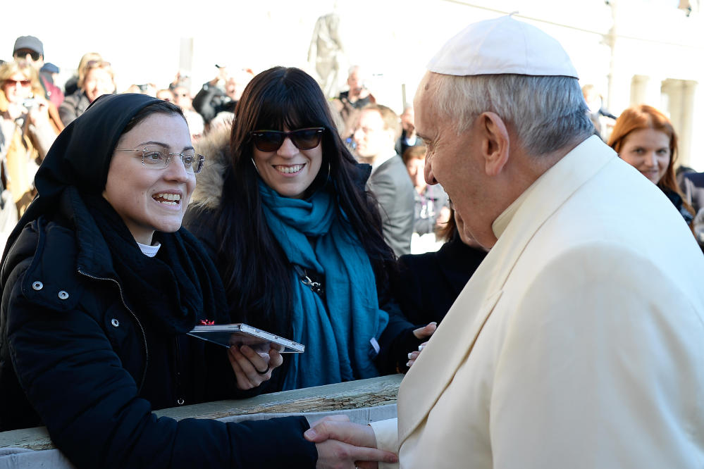 "Pope Francis greets Sister Cristina Scuccia as she gives him one of her CDs at the end of his weekly general audience at the Vatican on Wednesday. After winning the Voice of Italy singing contest, the Ursuline nun launched her first album ""Sister Cristina"" last month."