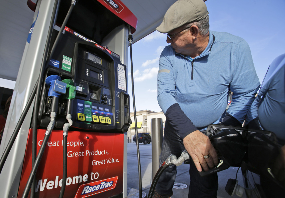 Eduardo Palacios-Paez, of Miami, pumps gas at a RaceTrac gasoline station in Hialeah, Fla. Motorists are now seeing prices under $3 a gallon for the first time in four years, which means that gas stations are paying less for the fuel, too. The Associated Press