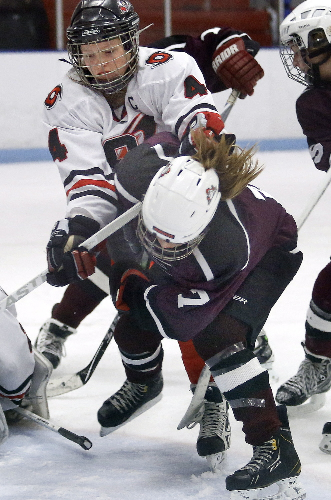Kristen Murray of Scarborough checks Greely's Bridget Roberts, drawing the game's only penalty. Roberts finished with two goals and an assist.