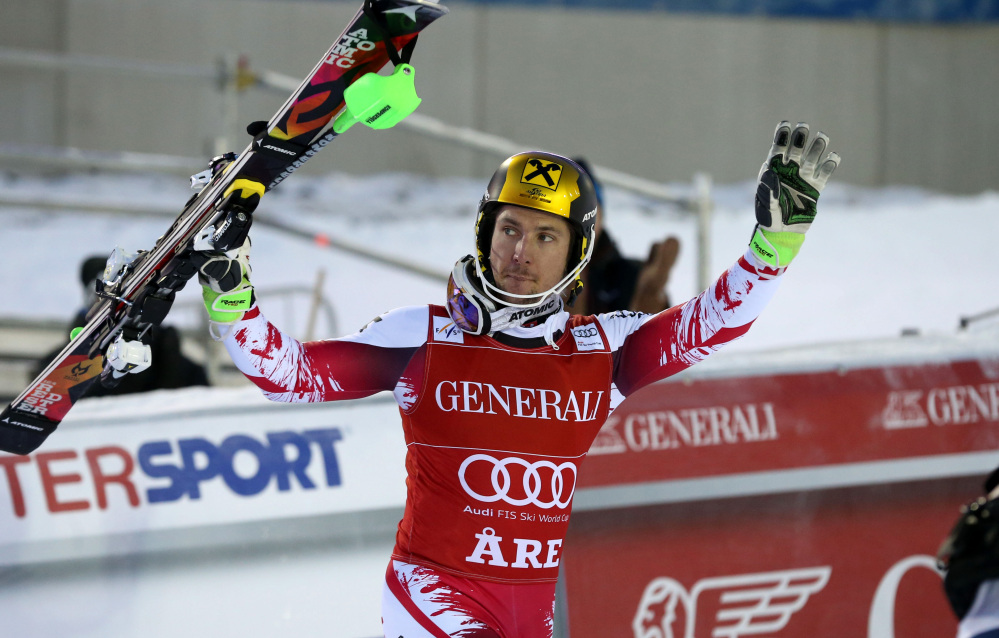 Marcel Hirscher celebrates in the finish area after winning an Alpine ski, men's World Cup slalom in Are, Sweden, on Sunday. Austrian skier Marcel Hirscher overcame a first-leg deficit to edge out German skier Felix Neureuther and win a World Cup slalom race for his 26th career victory.