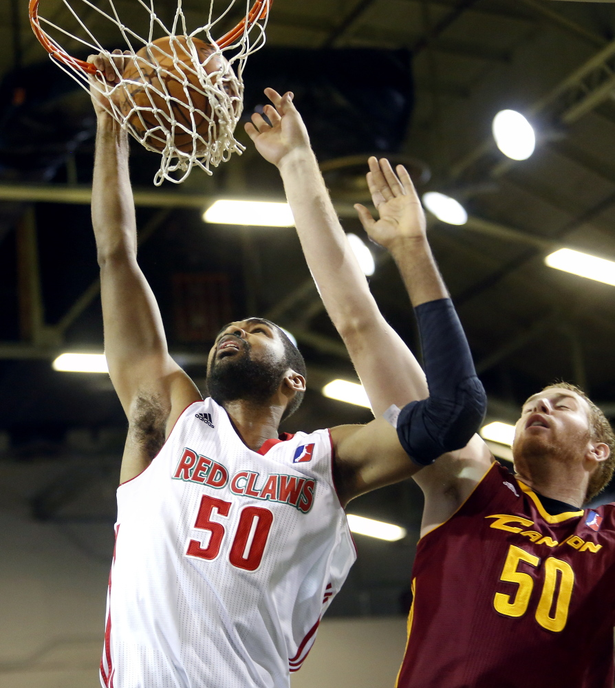 Ralph Sampson III dunks over Canton's Alex Kirk in Maine's 96-82 win Sunday at the Portland Expo. The Red Claws have the league's best record at 9-2.