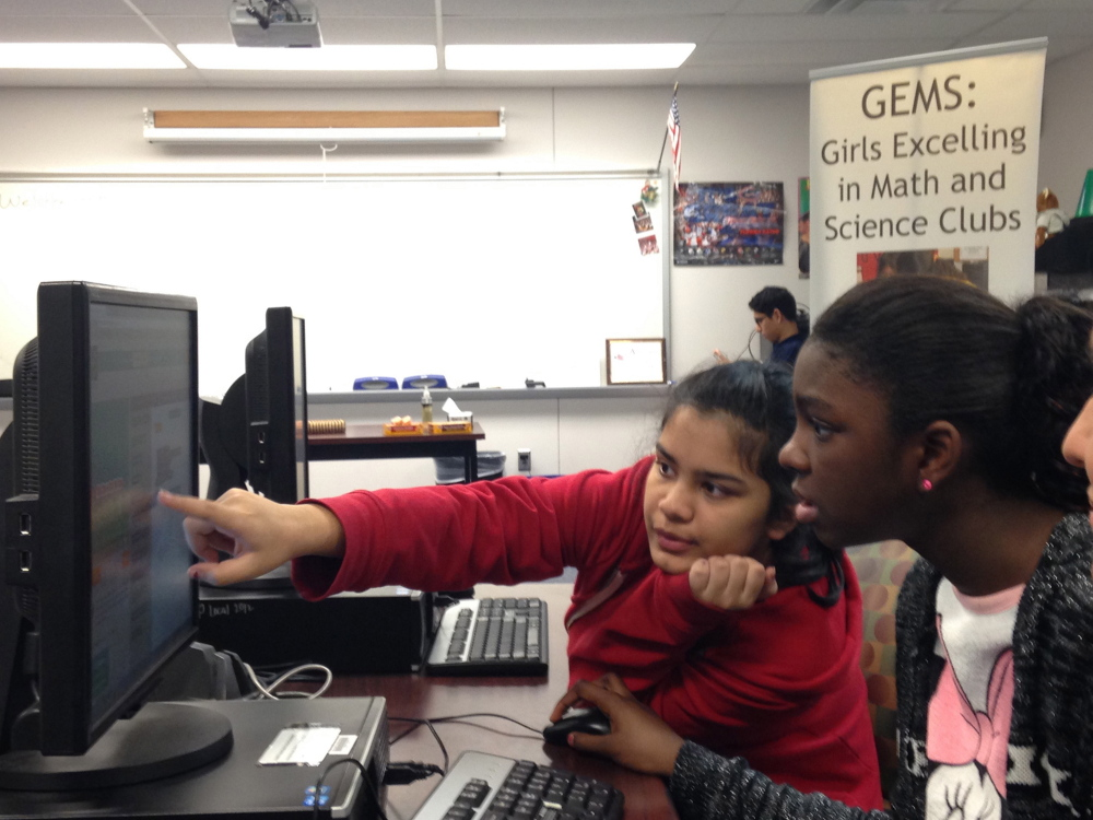 Pradeeti Mainali, 13, left, and Brieauna Johnson, 12, both students at Langston Hughes Middle School in Reston, Va., learn how to code at the GEMS (Girls Excelling in Math and Science) Hour of Code class at South Lakes High School in Reston.