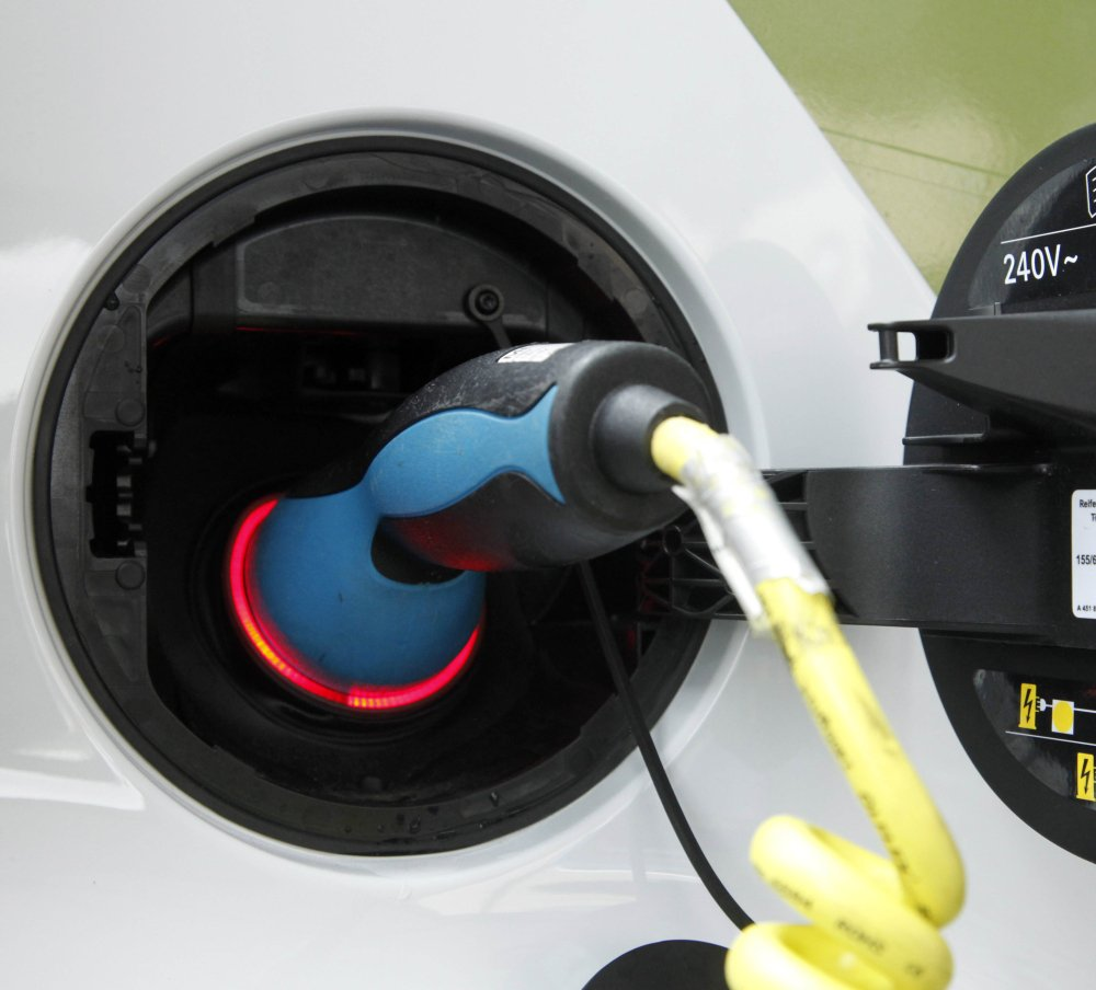 An electric car is charged with a plug. Researchers say all-electric cars are only as environmentally friendly as are their power sources. And  ethanol isn't so green.