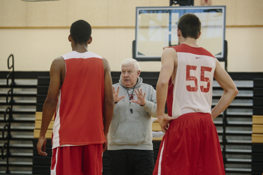 Harvey Moynihan  instructs players on defensive drills during practice at Scarborough High School Monday.