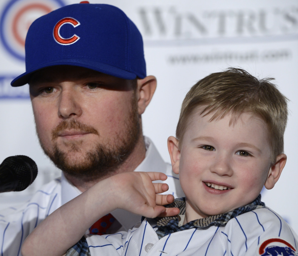New Chicago Cubs pitcher Jon Lester, seen with his son, Hudson, was a part of two World Series titles with the Red Sox – something the Cubs believe they can accomplish.