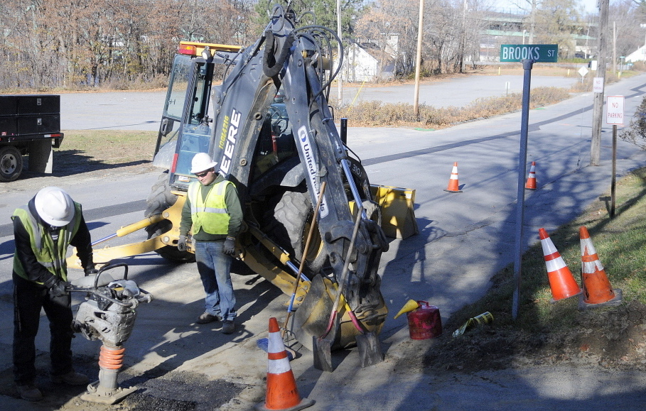Workers from Tetra Tech Construction, a former contractor for Summit Natural Gas, patch a street in Augusta last year.