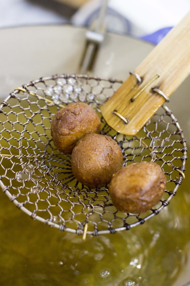"""This Nov. 3, 2014, photo shows chai-spiced doughnuts in Concord, N.H. The best kind of oil for these doughnuts is one that's flavorless and has a high """"smoke point."""" The smoke point is the temperature at which a given oil starts to smoke; it can catch fire if it gets much hotter than that. (AP Photo/Matthew Mead)"""