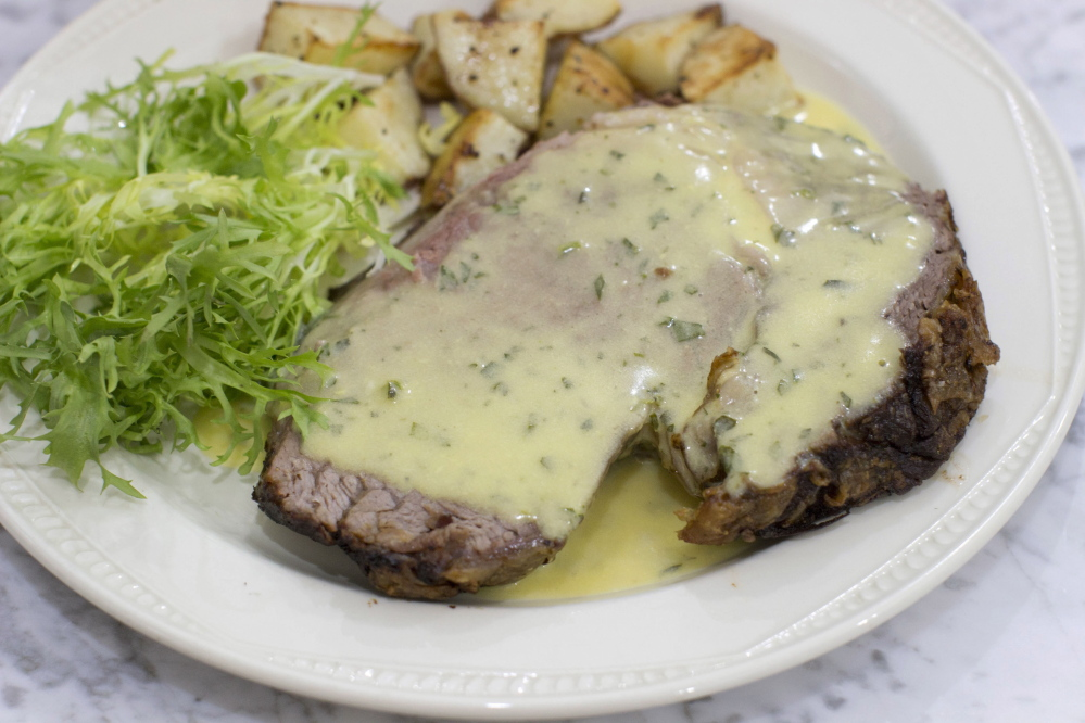 Slow roasted standing rib roast with bearnaise sauce. The reduction for the bearnaise sauce can be made while the roast is in the oven, then finished when the meat is resting.