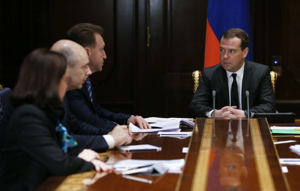 Russian Prime Minister Dmitry Medvedev met with advisers to focus on ways to shore up the ruble. Russia's central bank hiked an interest rate from 10.5 to 17 percent Monday to stem the flow of money out of the country.