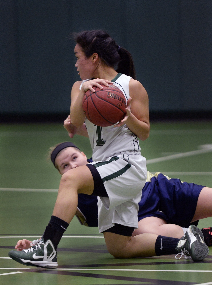 PORTLAND ME - DECEMBER 15: Waynflete's Helen Gray-Bauer comes up with a loose ball as Traip Academy's Cassidy Delano tries to get a hand on the ball Tuesday, December 16, 2014. (Photo by Shawn Patrick Ouellette/Staff Photographer)