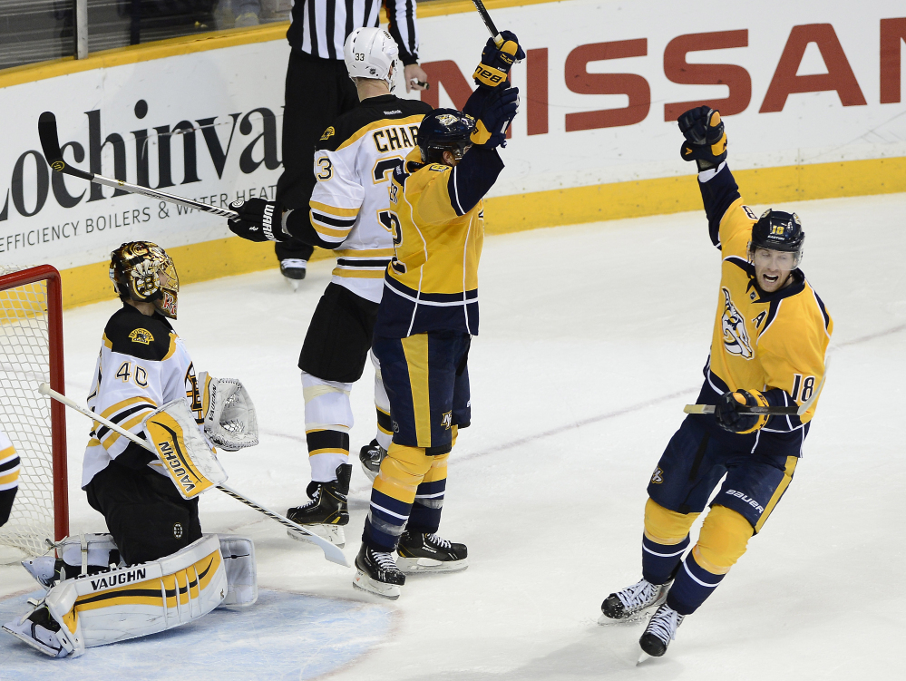 Nashville Predators center Mike Fisher, center, and James Neal celebrate after Fisher scored against Bruins goalie Tuukka Rask in the second period Tuesday night in Nashville, Tenn. The Bruins sent the game to overtime but lost in a shootout.