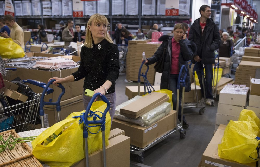 Consumers wait to pay Wednesday at the Ikea store on the outskirts of Moscow. The collapse of the national currency triggered a spending spree by Russians desperate to buy cars and home appliances before prices shoot higher.