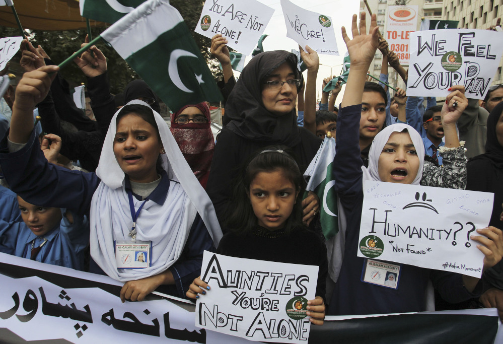 Pakistani students chant slogans to condemn to Tuesday's Taliban attack on a military-run school in Peshawar, during a demonstration Wednesday in Karachi, Pakistan.