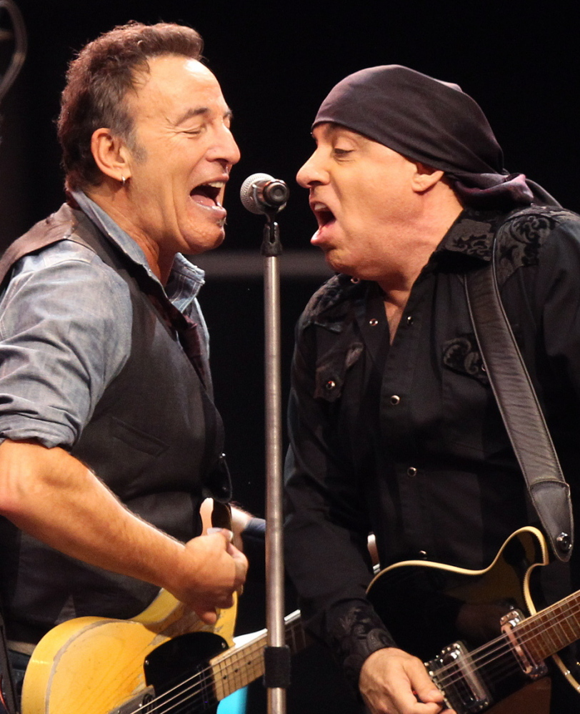 Bruce Springsteen, left, performs with Steven Van Zandt in the E Street Band.