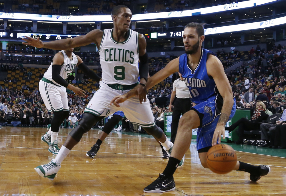 Orlando Magic guard Evan Fournier drives against the Celtics' Rajon Rondo during the first half of Wednesday night's game in Boston. Rondo led the way for Boston with 13 points, 15 assists and seven rebounds.
