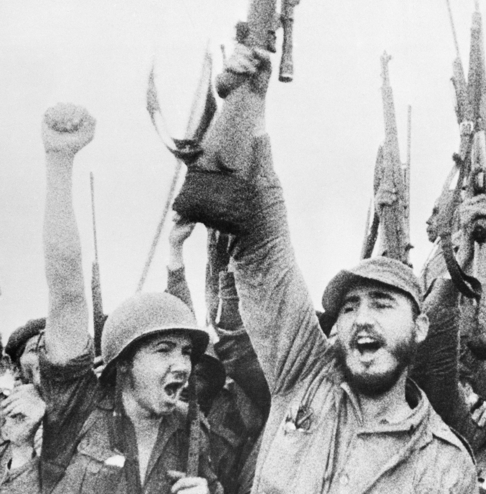 Fidel Castro celebrates with his troops in a photo taken in 1957.