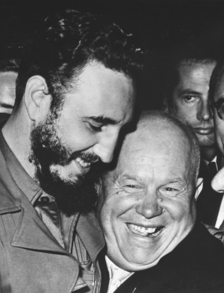 Castro and Soviet Premier Nikita Khrushchev embrace in 1960.