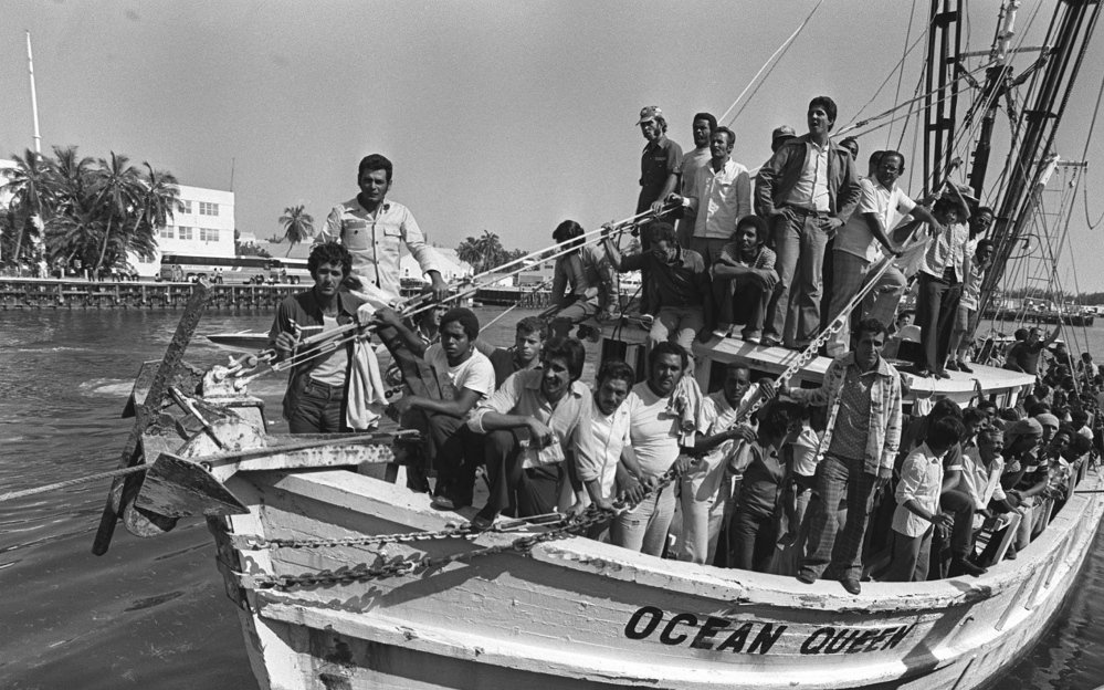 "A shrimp boat returning from Mariel, Cuba, is packed with Cuban refugees as it lands at Floriday's Key West Naval Base on April 30, 1980.  President Jimmy Carter said in May 1980 that Cubans leaving the port of Mariel would be welcomed in the United States with ""open hearts and open arms."" That was after Castro opened the port in April 1980 to anyone who wanted to go. A few weeks later, Carter ordered the ""freedom flotilla"" stopped as America was overwhelmed by an average of 1,000 new arrivals daily. (AP Photo)"
