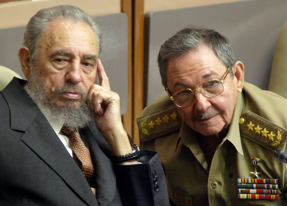 FILE - In this July 31, 2004 file photo, Cuba's President Fidel Castro, left, and his brother, Minister of Defense Raul Castro, attend a Parliament session in Havana, Cuba. The 1991 collapse of the Soviet Union devastated the Cuban economy, but the country limped along, first under Fidel and then, after he fell ill in 2006, under his brother Raul, head of the Cuban military. On Wednesday, Dec. 17, 2014, the U.S. and Cuba agreed to re-establish diplomatic relations and open economic and travel ties, marking a historic shift in U.S. policy toward the communist island after a half-century of enmity dating back to the Cold War. (AP Photo/Cristobal Herrera, File)