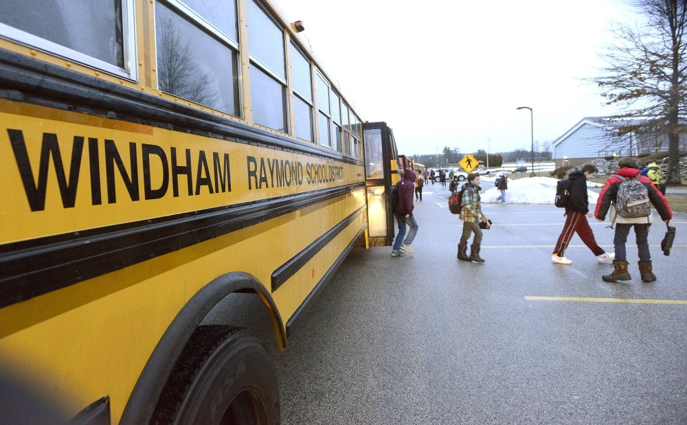 WINDHAM, ME - DECEMBER 18: Middle school students get off the bus as students return to Windham schools after a threat canceled three days of classes. (Photo by John Patriquin/Staff Photographer)