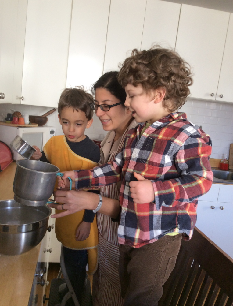 Adán Cuauhtémoc Anderson, 4, his mother, Esmeralda Ulloa, and the author's son, Theo, 4, making Mexican pan dulce.