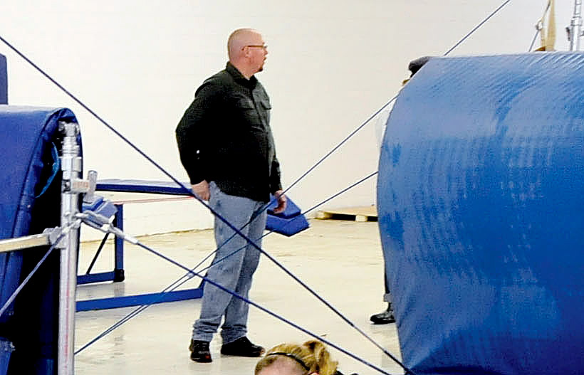 Dennis Hanson, of Wilton, helps clean up water damage at Decal Gymnastics in Farmington last winter. Hanson died in a car accident Thursday in Wilton. His young daughters were avid gymnasts. Members of the club where they trained said Hanson often helped out at the facility where his daughters trained.