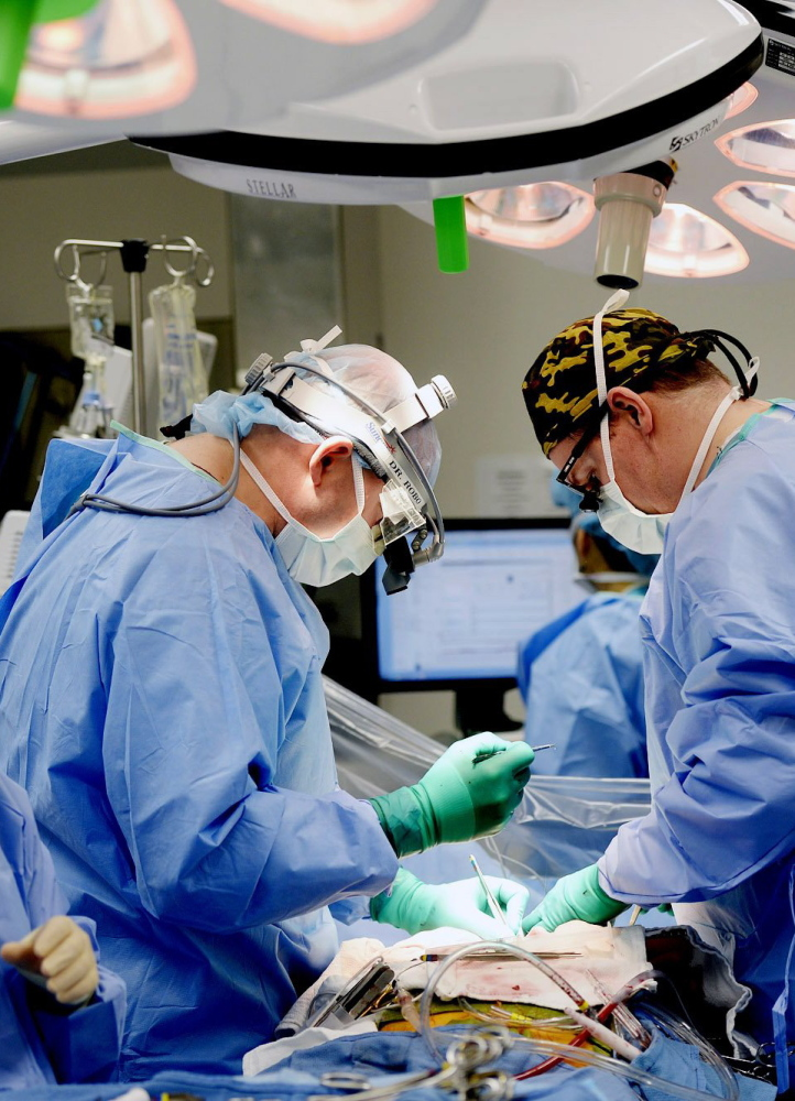 Maine Medical Center doctors and surgery staff in an operating room. Telegram File Photo