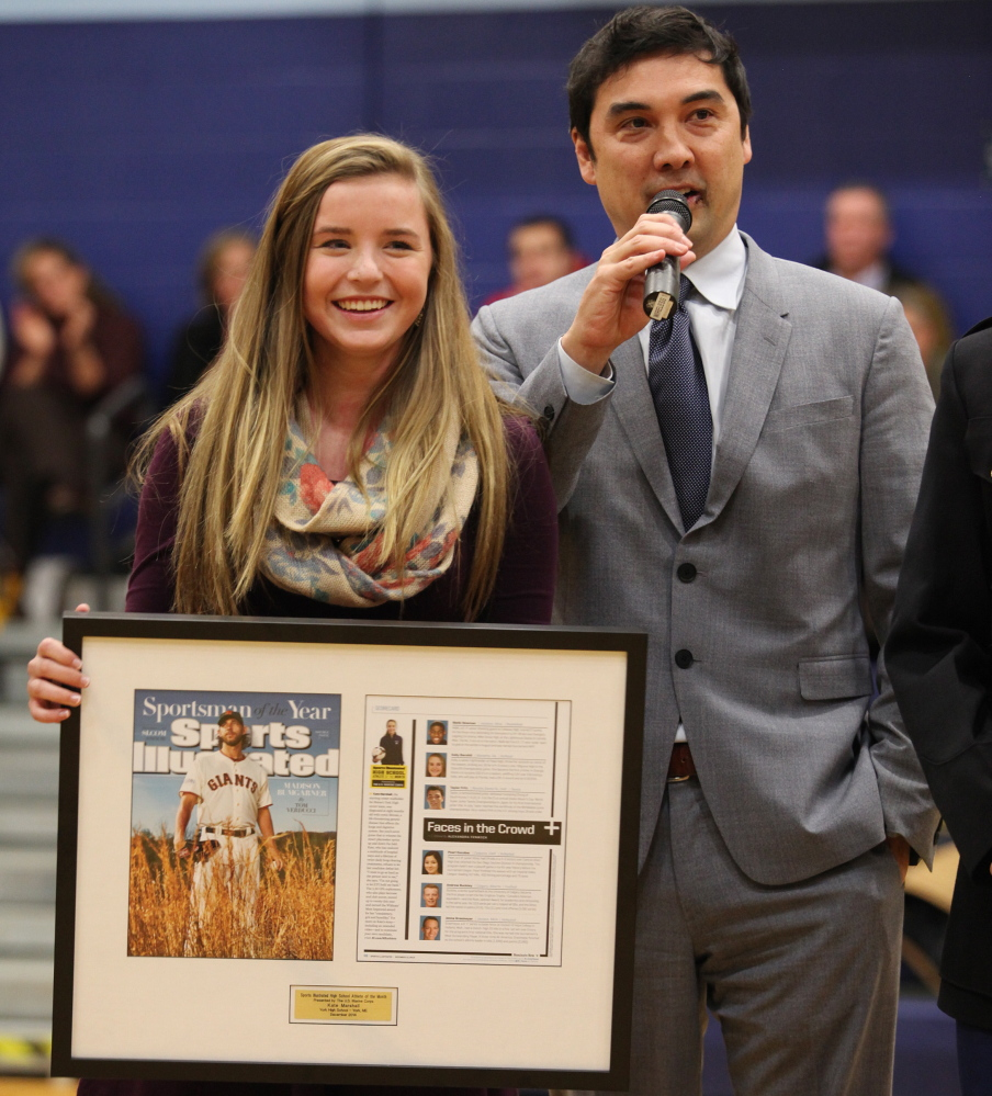York soccer player Kate Marshall receives a plaque from Chris Stone, managing editor of Sports Illustrated, in recognition of her selection as the magazine's High School Athlete of the Month for December. Marshall, a sophomore, was a starting midfielder for the Wildcats this fall and plays year-round for a club team despite having cystic fibrosis.