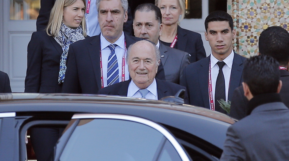FIFA president Sepp Blatter, center, leaves his hotel to lead a meeting of the soccer governing body's executive committee in Morocco. FIFA faces criticism for its lack of transparency.
