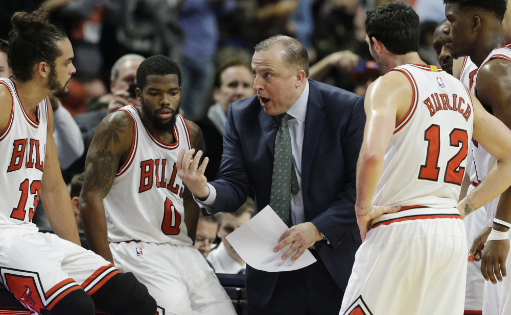 Chicago Coach Tom Thibodeau talks to his team during the second half of the Bulls' 103-97 victory over the New York Knicks on Thursday night in Chicago. Each team was missing a star in the game – Derrick Rose for the Bulls, and Carmelo Anthony for the Knicks.