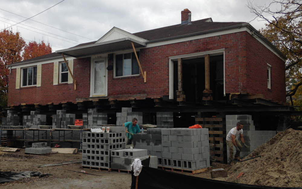 A house in Norfolk, Va., is being raised to defend against flooding. Cinder blocks are used to create a new foundation that puts the house 10 feet higher off the ground – at a cost of $80 to $100 a square foot.  Bloomberg News photo by Heather Perlberg