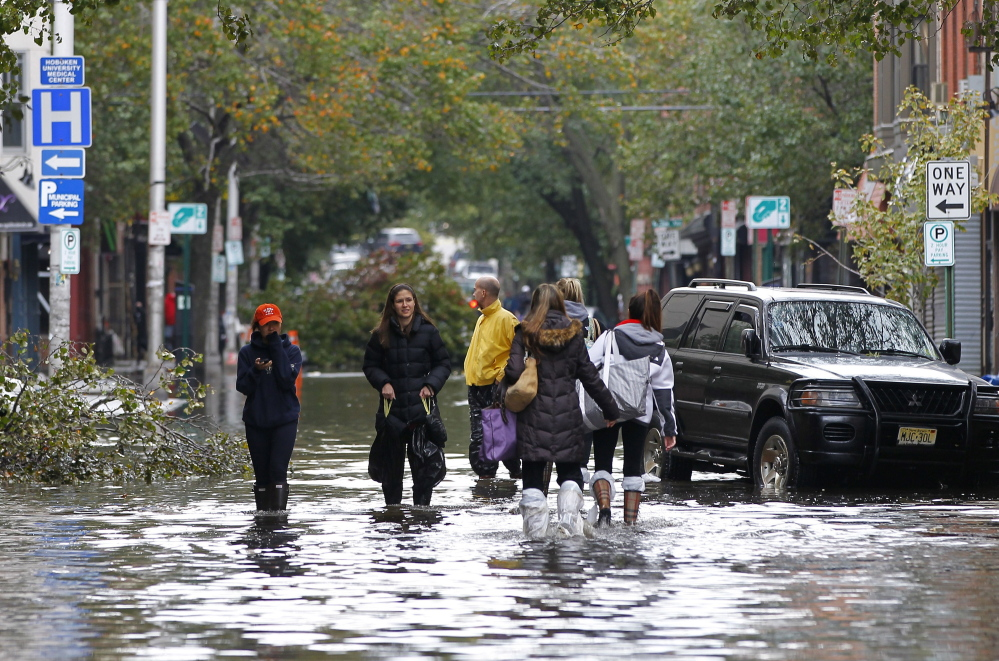 The power of Hurricane Sandy was clear to residents of Hoboken, N.J., as they waded through floodwaters on Oct. 31, 2012. The monster storm crippled transportation, knocked out power for millions and killed at least 45 people in nine states.