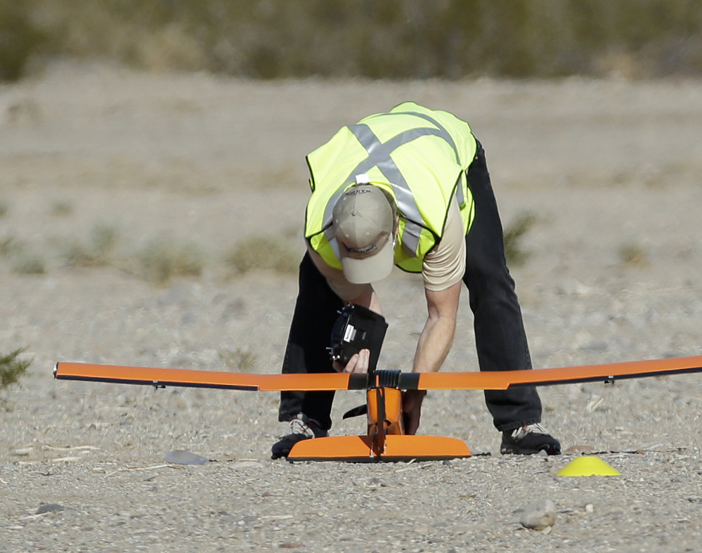 Scott Carrigan of Sensurion Aerospace picks up the company's Magpie commercial drone after it crashed during launch Friday near Boulder City, Nev.