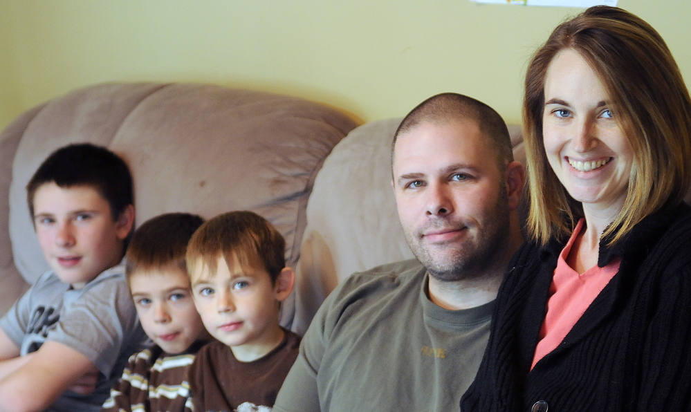 Cyndi MacMaster with her husband, Scott, and sons Tripp, 5, center, Parker, 7, and Jake, 12, at their Dresden home on Dec. 7. Cyndi MacMaster died Friday after battling a second bout of cancer. Fundraisers to help the family will go on, organizers said.