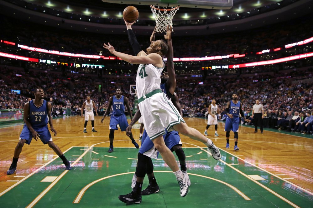 Boston Celtics center Kelly Olynyk shoots a reverse layup on a drive to the basket against the Minnesota Timberwolves during the first quarter of Friday night's game in Boston. Olynyk finished with 21 points.