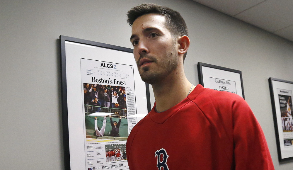 Pitcher Rick Porcello leaves an introductory news conference in Boston on Friday. Porcello recalled his first start in Fenway, which involved a fight with Kevin Youkilis.