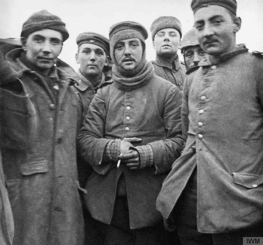In this image provided by the Imperial War Museum, World War I German and British soldiers stand together on the battlefield near Ploegsteert, Belgium during Dec. 1914. Soldiers who had been killing each other by the tens of thousands for months climbed out of their soggy trenches to seek a shred of humanity amid the horrors of World War I. Hands reached out across the divide and in Flanders Fields a century ago, a spontaneous Christmas truce ever so briefly lifted the human spirit.