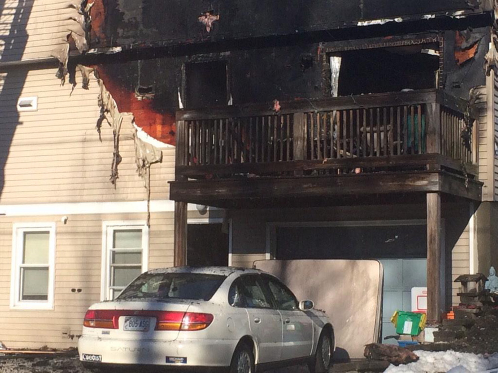 The four-unit building on Unity Lane in Freeport was damaged by fire on Saturday.