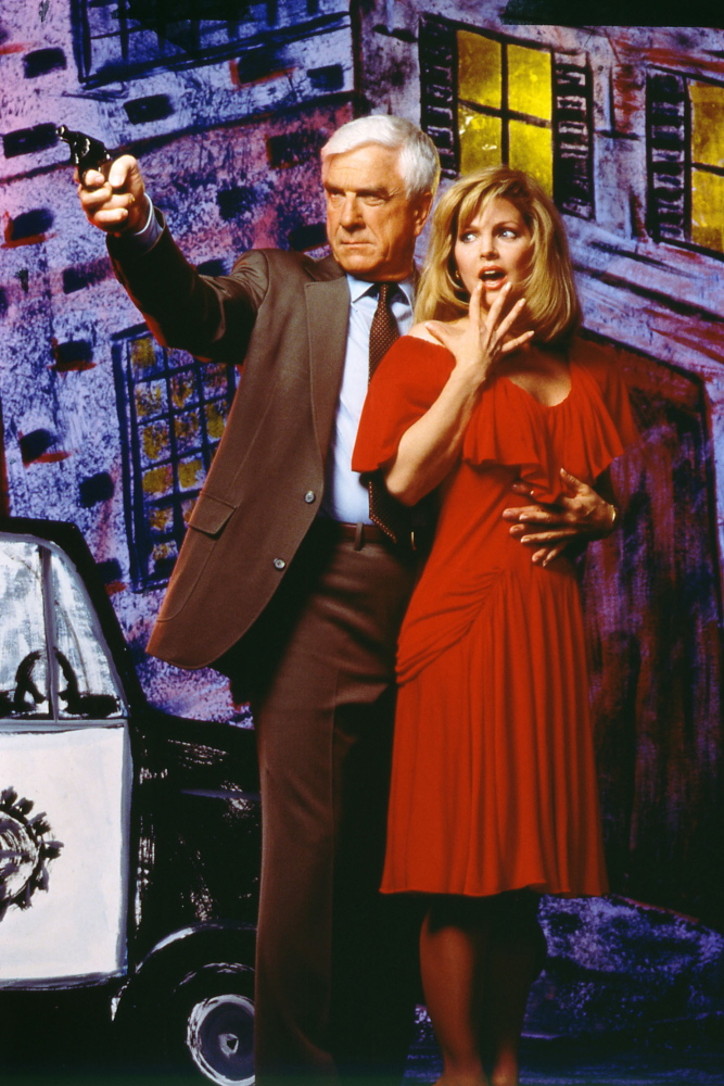 "This 1988 publicity photo shows actor Leslie Nielsen, left, with actress Priscilla Presley in the film, ""The Naked Gun: From the Files of Police Squad!"""