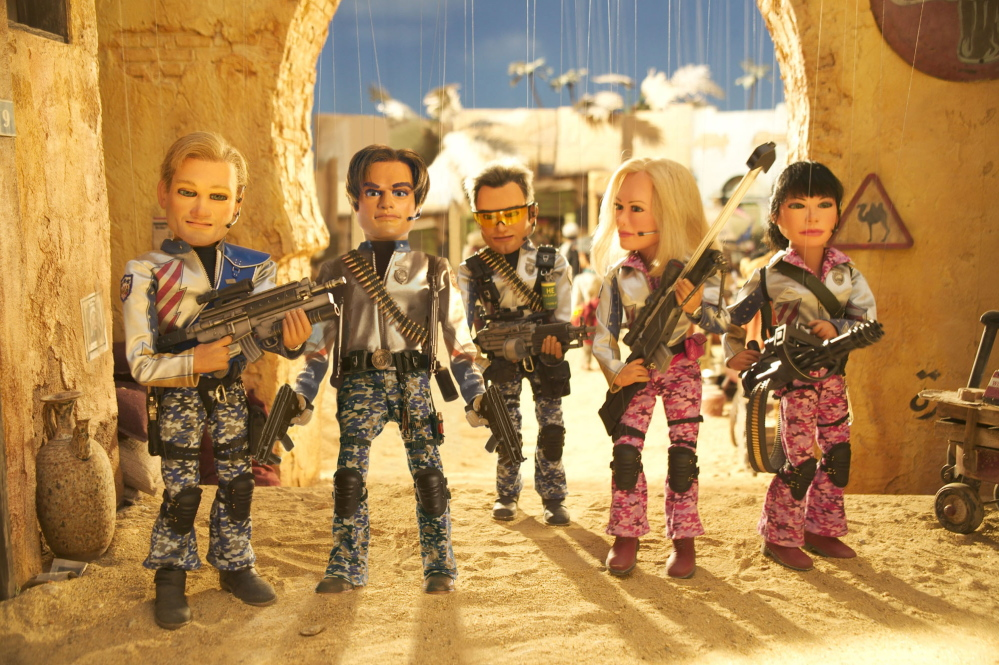 "From left, Joe, Gary, Chris, Lisa and Sarah in a Scott Rudin/Matt Stone production of a Trey Parker film, ""Team America: World Police,"" from Paramount Pictures."