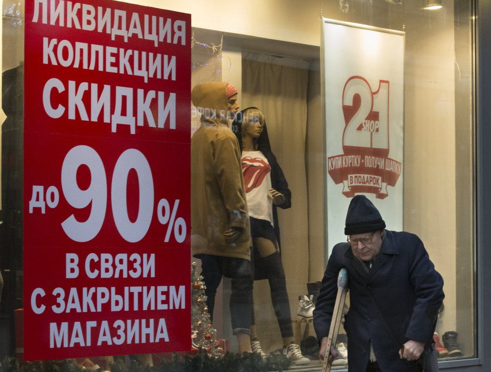 A store in Moscow advertises a 90 percent off sale on Thursday. The Russian economy is stuttering due to pressure from U.S.-led sanctions.