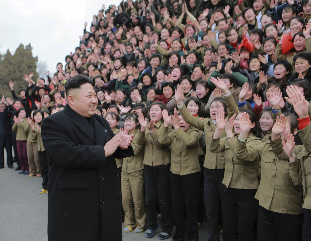 Kim Jong Un greets a crowd in Pyongyang, North Korea. His government denies responsibility for a cyberattack on Sony Pictures Entertainment.