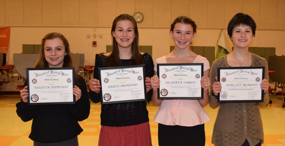 "Winners of the 2014 ""Patriot's Pen"" essay contest include, from left, Wells Junior High School students Hailey Tostenson, Daisy Aromando and Delaney O'Brien. Wells High freshman Estelle Reardon, right, placed second in the ""Voice of Democracy"" contest."