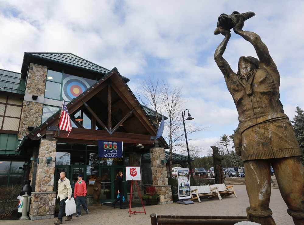 Shoppers carrying purchases leave Kittery Trading Post on Saturday.