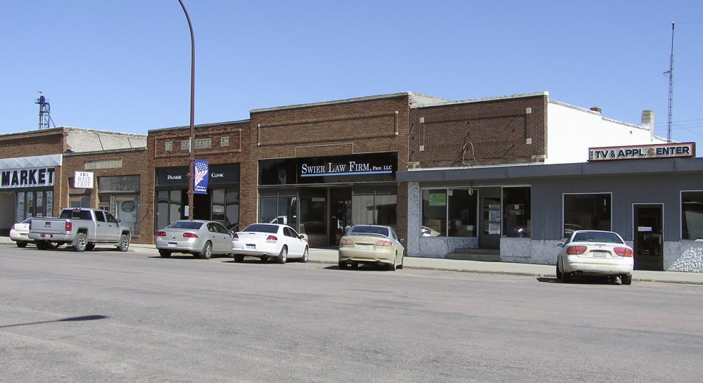 This June 12, 2014 photo shows the new Swier Law Firm nestled between businesses in Corsica, S.D., a rural town of 600. A program in South Dakota is helping to lure attorneys from big cities to sparsely populated areas. Although federal grant money for decades has been available for doctors, nurses and dentists willing to relocate to sparsely populated areas, the South Dakota program is believed to be the first of its kind to similarly compensate lawyers. (AP Photo/Regina Garcia Cano)