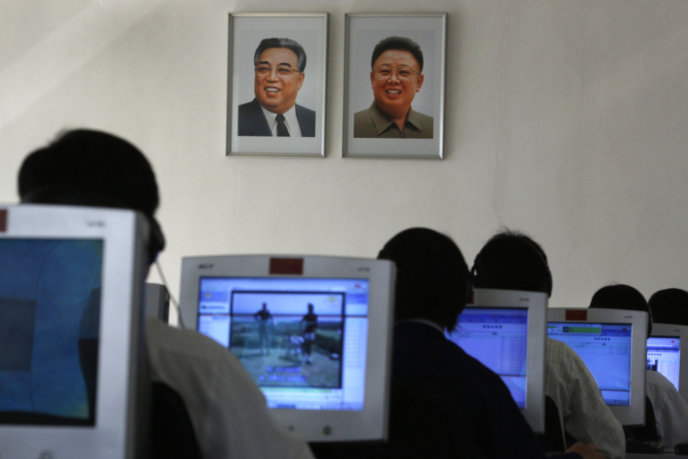 In this Thursday, Sept. 20, 2012 file photo, North Korean students use computers in a classroom with portraits of the country's later leaders Kim Il Sung, left, and his son Kim Jong Il hanging on the wall at the Kim Chaek University of Technology in Pyongyang.