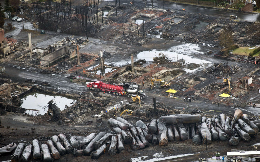 Workers comb through debris after an unmanned train with 72 railway cars carrying crude oil derailed in July 2013, causing explosions in Lac-Megantic, Quebec.