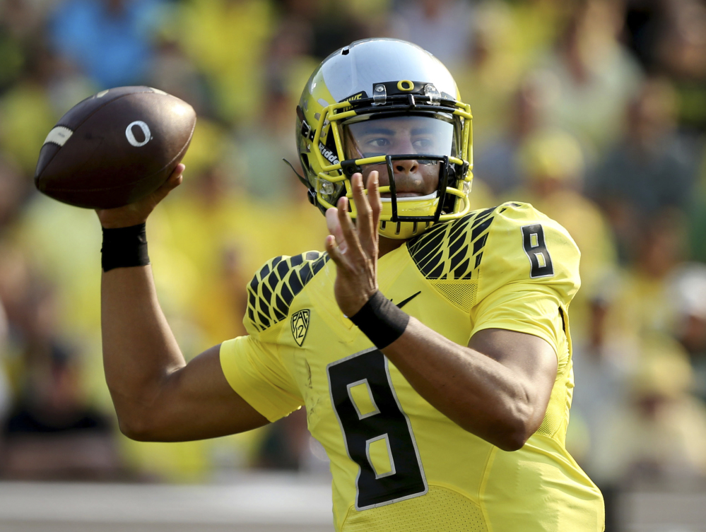 Oregon quarterback Marcus Mariota is The Associated Press college football player of the year. He received 49 of the 54 votes submitted by the AP Top 25 media panel.