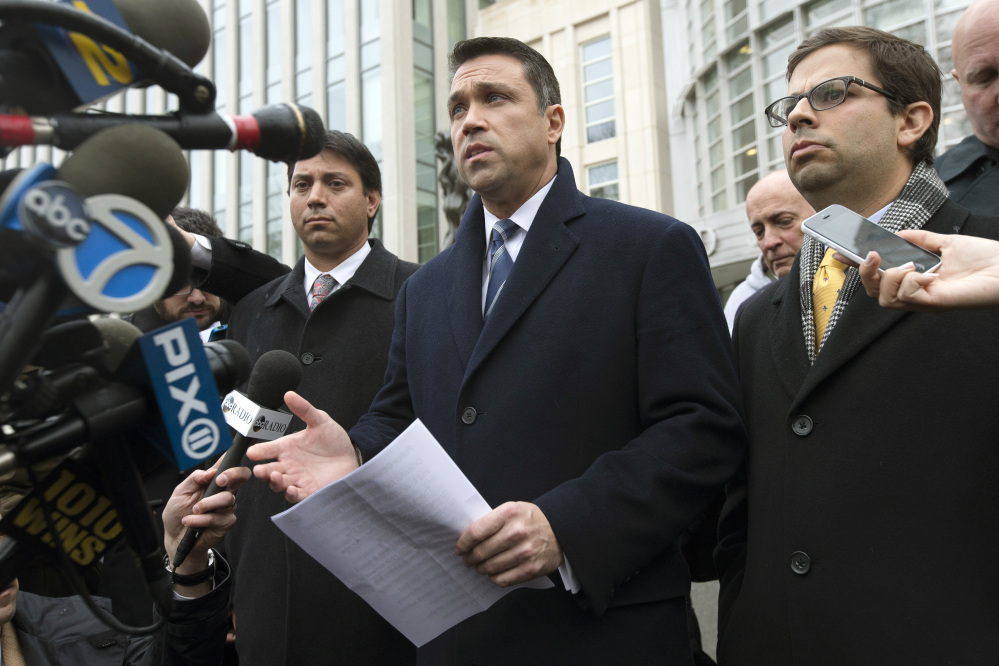 Rep. Michael Grimm speaks to the media outside federal court in Brooklyn after pleading guilty Tuesday to a federal tax evasion charge. Grimm had been set to go to trial in February on charges of hiding more than $1 million in sales and wages while running a health-food restaurant in Manhattan