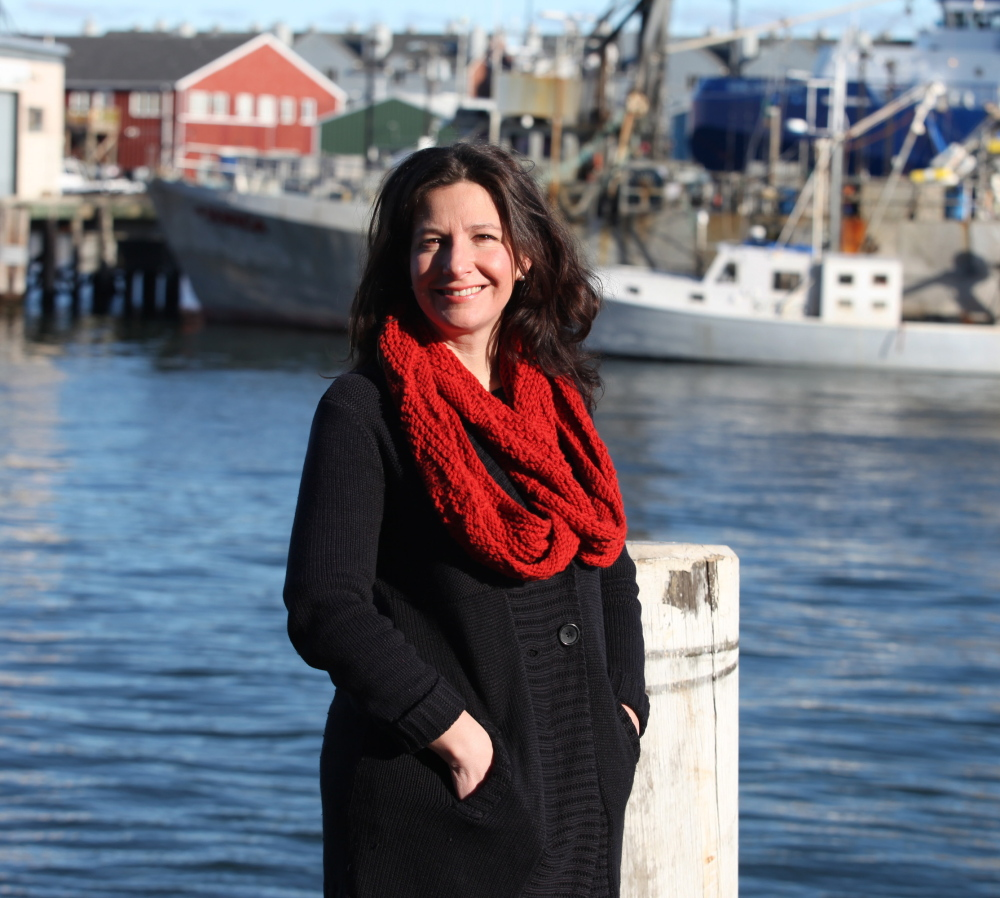 PORTLAND, ME - DECEMBER 19: Jen Levin, Sustainable Seafood Program Manager at the Gulf of Maine Research Institute poses Friday, Dec. 19, 2014 along the waterfront in Portland, Maine. Photo by Joel Page/Staff Photographer)
